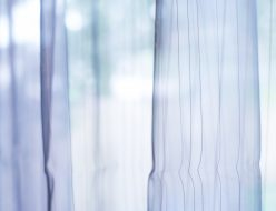 Transparent curtain on window. Curtain background